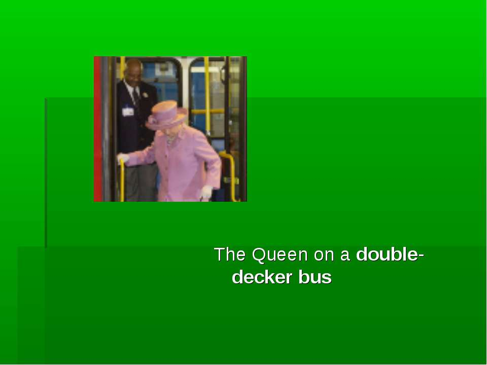 The Queen on a double-decker bus