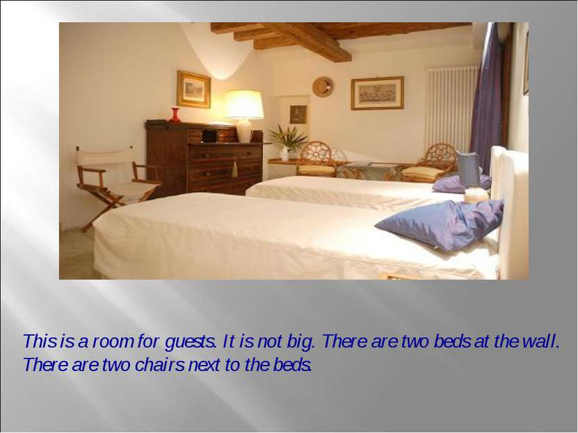 This is a room for guests. It is not big. There are two beds at the wall. The...
