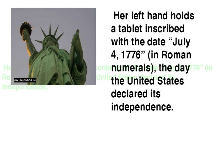 "Her left hand holds a tablet inscribed with the date ""July 4, 1776"" (in Roman..."