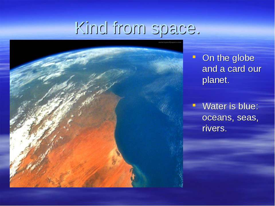Kind from space. On the globe and a card our planet. Water is blue: oceans, s...