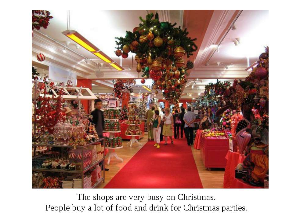The shops are very busy on Christmas. People buy a lot of food and drink for ...