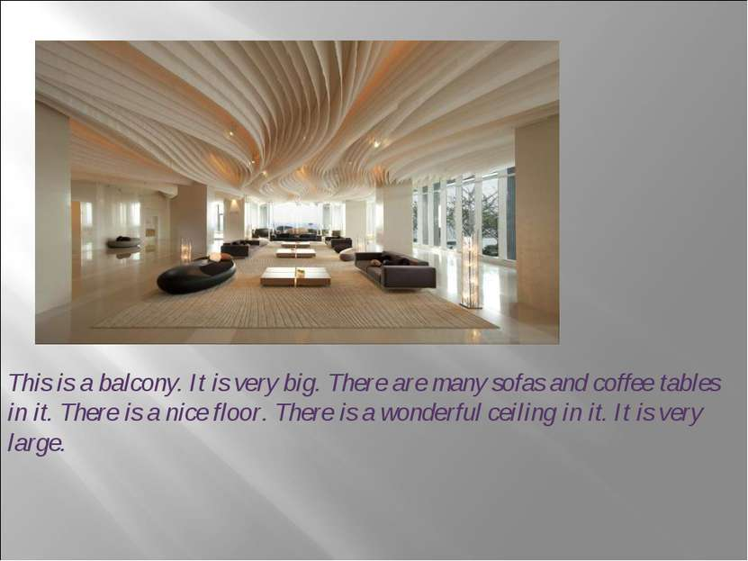 This is a balcony. It is very big. There are many sofas and coffee tables in ...